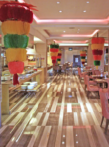 Native decorations such as kiping (brightly-colored, lead-shaped wafer made of rice paste) adorn Café Ilang-Ilang, resembling a Filipino fiesta that is sure to make an unforgettable Filipino food dining experience.