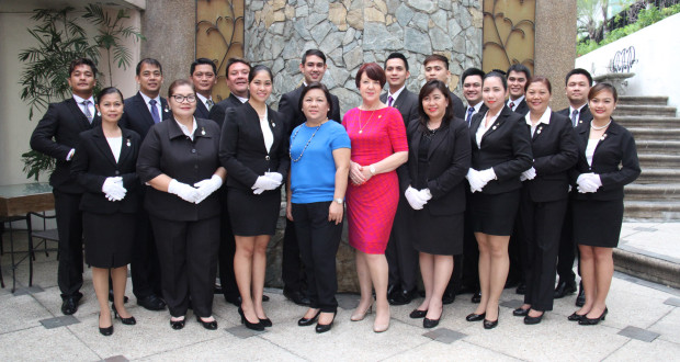 Josephine Ive (in red) with Marinela Trinidad (in blue), Cravings Group and ASHA CEO, and the graduates of the 7-Star Butler Service.