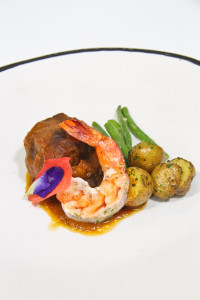 Braised Beef Short ribs with Roasted Garlic Mashed Potatoes, Grilled Giant Prawns with Herbed Butter, Sautéed Haricot Verts